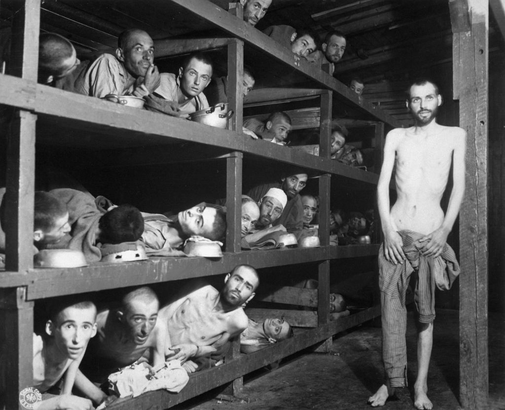 Buchenwald concentration camp, 1945. Elie Wiesel is in the second row from the bottom, seventh from the left, next to the bunk post (Private H Miller / Wikipedia)
