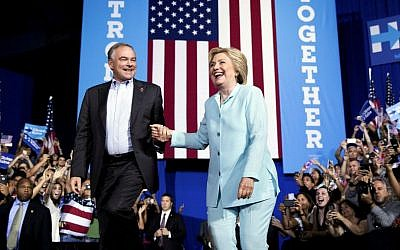 Democratic presidential candidate Hillary Clinton and running mate Sen. Tim Kaine, D-Virginia, take the stage together at a rally at Florida International University Panther Arena in Miami, Saturday, July 23, 2016. (AP Photo/Andrew Harnik)