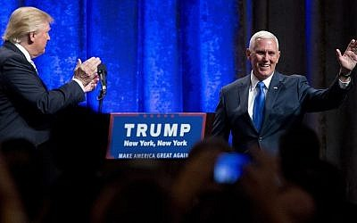 Republican presidential candidate Donald Trump, left, introduces Indiana Gov. Mike Pence, during a campaign event to announce Pence as the vice presidential running mate on, Saturday, July 16, 2016, in New York (AP Photo/Mary Altaffer)
