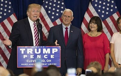 Republican presidential candidate Donald Trump speaks at a reception with friends and family following the Republican National Convention, Friday, July 22, 2016, in Cleveland. Listening are vice presidential running mate Gov. Mike Pence, R-Ind., Karen Pence, and Charlotte Pence. (AP Photo/Evan Vucci)