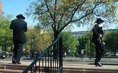 Illustrative: Orthodox Jewish men walking near Chabad headquarters in Brooklyn, NY, May 12, 2008. (Serge Attal/Flash90)