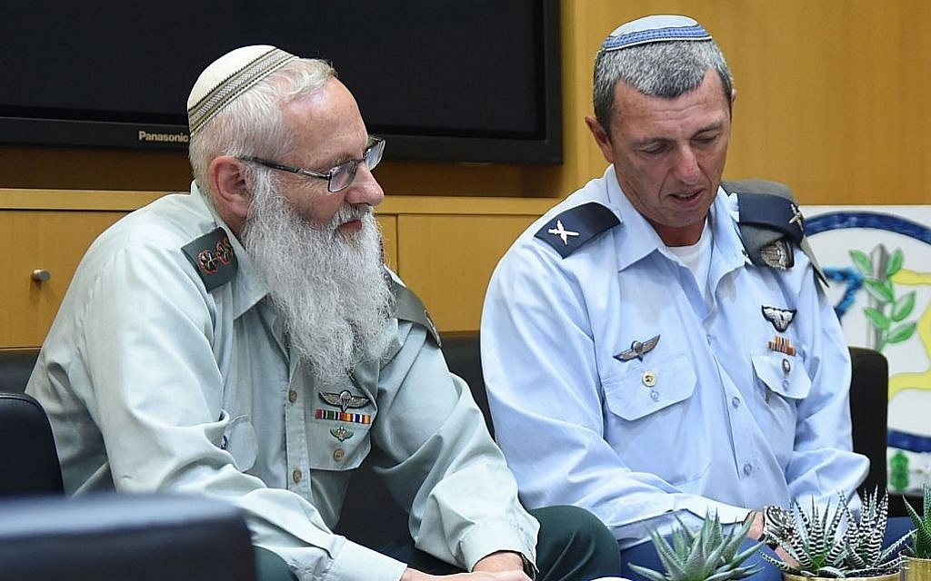 Rabbi Col. Eyal Karim (left), nominated to become IDF chief rabbi, sits next to his predecessor, Brig. Gen. Rafi Peretz, on April 21, 2016 (Diana Khananashvili/Defense Ministry)