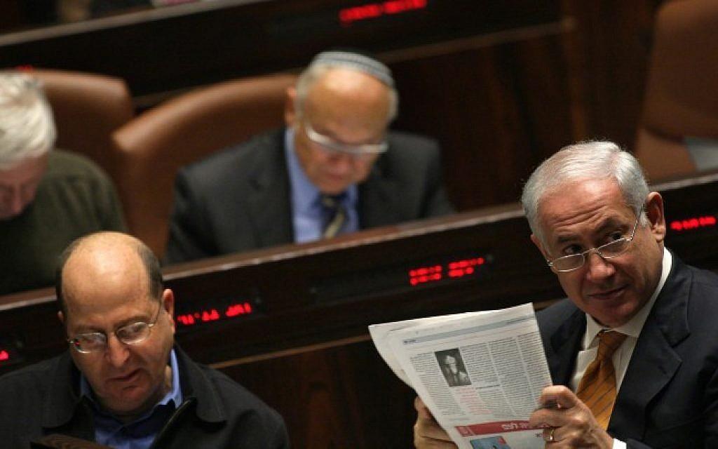Prime Minister Benjamin Netanyahu reads a newspaper in the Knesset. Jan 06, 2010. (Kobi Gideon/ FLASH90)