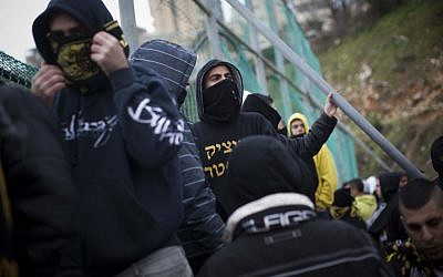 Beitar Jerusalem  fans protest the decision to sign two Chechen Muslims players Zaur Sadayev and Gabriel Kadiev, February 1, 2013. (Yonatan Sindel/Flash90)