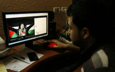 Illustrative: A Gazan man looking at a pro-Palestinian post on Facebook on April 7, 2013. (Abed Rahim Khatib / Flash90)