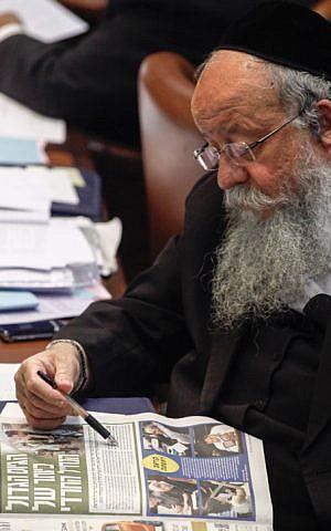 United Torah Judaism MK Menachem Eliezer Moses reads a newspaper at the Knesset plenum in Jerusalem, July 31, 2013. (Flash90)