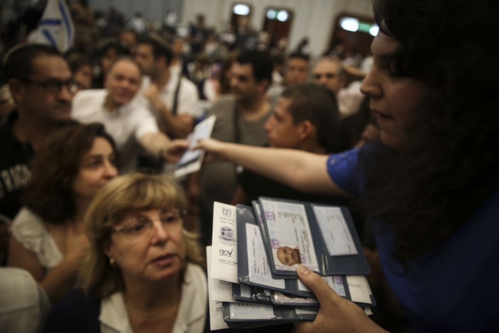 Handing out new identity cards to French immigrants in July 2014 Hadas Parush/Flash 90)