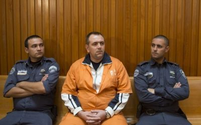 Roman Zadorov, convicted for the 2006 murder of Tair Rada, sits in the courtroom of the Supreme Court, in Jerusalem on October 20, 2014. (Yonatan Sindel/Flash90)