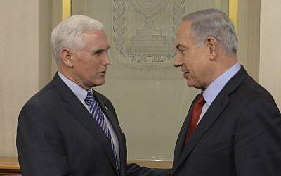 Israeli Prime Minister Benjamin Netanyahu (R) meets with Indiana Governor Michael Pence in Jerusalem on December 29, 2014. (Amos Ben Gershom/GPO)