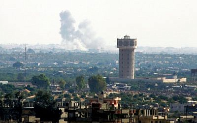 Smoke rises after an airstrike in the Sinai city of Rafah as seen from Gaza on July 1, 2015. (Abed Rahim Khatib /Flash90)