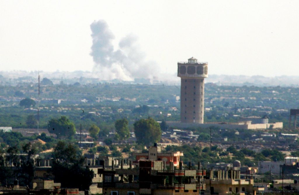 Smoke rises after an airstrike in the Sinai city of Rafah as seen from Gaza