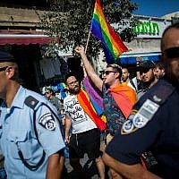 LGBT members surrounded by hundreds of Israeli police officers march on Jaffa street in Jerusalem on August 14, 2015, following the stabbing attack at the annual Jerusalem pride parade on July 30, 2015. (Yonatan Sindel/Flash90)