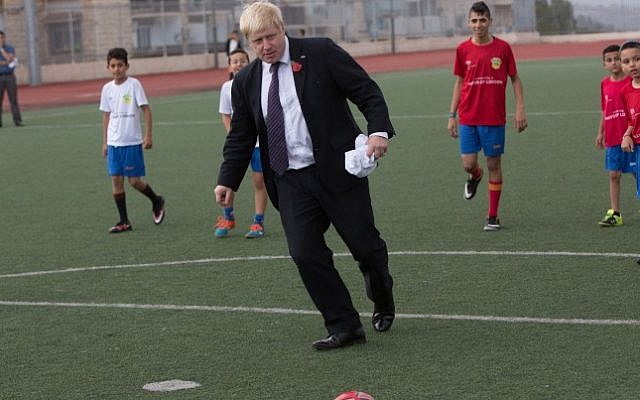 Boris Johnson kicks the ball during a ceremony and a soccer match with the 'Equaliser' football project, a mixed soccer team of Arab and Jewish youth in Jerusalem on November 10, 2015. (Yonatan Sindel/Flash90)