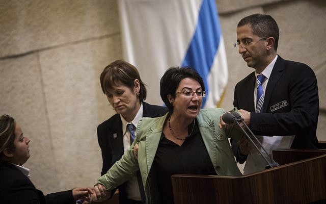 Joint List party member Hanin Zoabi is removed by Knesset security during her speech at a plenum session in the Knesset on February 8, 2016. (Hadas Parush/Flash90)