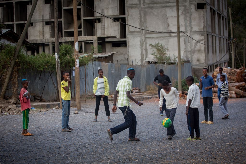 Members of the Falash Mura Jewish Ethiopian community play soccer in the street, after attending prayer services at the synagogue in Gonder, Ethiopia during Passover, April 26, 2016. (Miriam Alster/FLASH90)