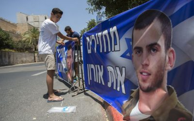 Brother of late Israeli soldier Oron Shaul seen at a protest tent outside the Prime Minister Benjamin Netanyahu's residence in Jerusalem on June 30, 2016. The sign reads 'Returning Oron.' (Photo by Yonatan Sindel/Flash90)