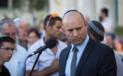 Education Minister Naftali Bennett delivers a eulogy at the funeral ceremony for Hallel Yaffa Ariel in the Jewish settlement of Kiryat Arba, in the West Bank, on June 30, 2016. (Yonatan Sindel/Flash90)