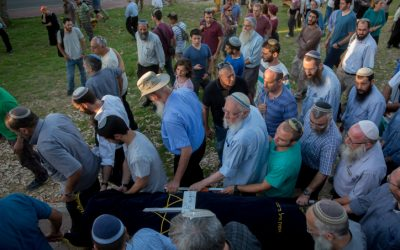 Friends and family members of Hallel Yaffa Ariel carry her body during her funeral procession in the Jewish settlement of Kiryat Arba, in the West Bank, on June 30, 2016. (Yonatan Sindel/Flash90)