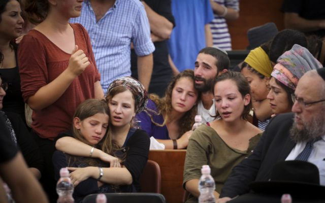 The children of Rabbi Miki Mark mourn at a service prior to his funeral at the Otniel yeshiva, where Rabbi Mark was director, on July 3, 2016. (Hadas Parush/FLASH90)