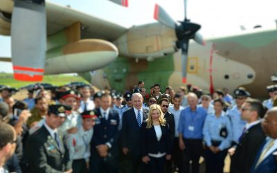 Benjamin Netanyahu and his wife Sara surrounded by IDF pilots and officers (blurred out), in Entebbe, Uganda, on July 4, 2016. (Kobi Gideon/GPO)
