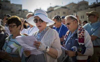 Members of the Reform and Conservative Jewish movements hold a mixed men and women prayer at the public square in front of the Western Wall, in Jerusalem's Old City, on July 4, 2016. (Yonatan Sindel/Flash90)