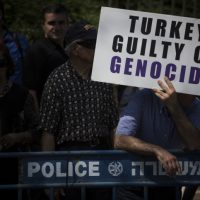 Members of the Jerusalem Armenian community protest outside the Knesset following the Israeli government's recent diplomatic agreement with Turkey, demanding that the State of Israel finally recognize the Armenian Genocide, July 5, 2016 (Hadas Parush/Flash90)