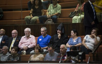 Members of the Jerusalem Armenian community attend the Knesset plenary discussion and vote to hold an official day marking the Armenian genocide, on July 5, 2016. (Hadas Parush/Flash90)