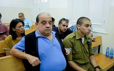 Elior Azaria, an Israeli soldier on trial for manslaughter, with his father Charlie, at a military court in Jaffa, July 06, 2016. (Flash90)