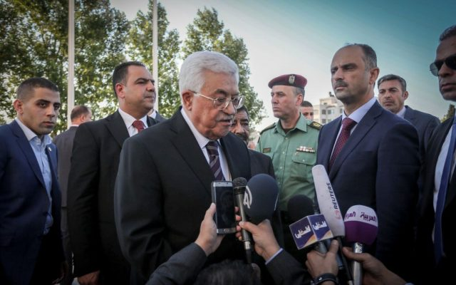 Palestinian Authority President Mahmoud Abbas takes part in a prayer session ahead of the Eid al-Fitr holiday marking the end of Ramadan, in Ramallah on Wednesday, July 6, 2015. (Flash90)