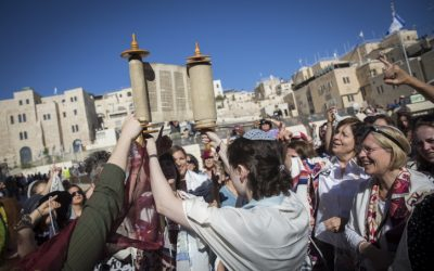 Members of the Women of the Wall hold a Rosh Hodesh (New Jewish month) prayer with a Torah Scroll they snuck in at the Western Wall, in Jerusalem's Old City, on July 7, 2016 (Hadas Parush/Flash90)