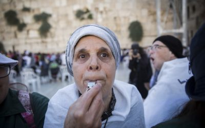 An ultra-Orthodox woman whistles in protest of the Women of the Wall group's Rosh Hodesh (New Jewish month) prayer at the Western Wall, in Jerusalem's Old City, on July 7, 2016 (Hadas Parush/Flash90)