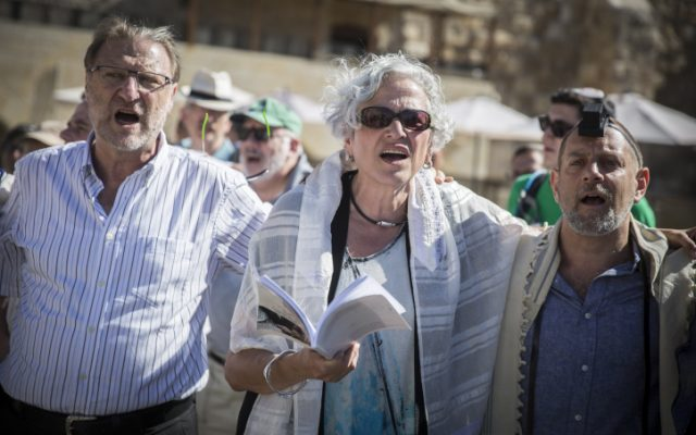 Members of the Reform and Conservative Jewish movements hold a mixed men and women prayer at the public square in front of the Western Wall, in Jerusalem's Old City, on July 7, 2016.(Hadas Parush/Flash90)