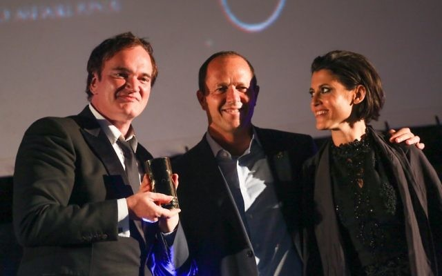 American filmmaker and actor Quentin Tarantino (left) receiving an award from Jerusalem Mayor Nir Barkat (center) and Jerusalem Cinematheque director Noa Regev (right) at the opening night of the Jerusalem Film Festival, on July 7, 2016. (Hadas Parush/Flash90)