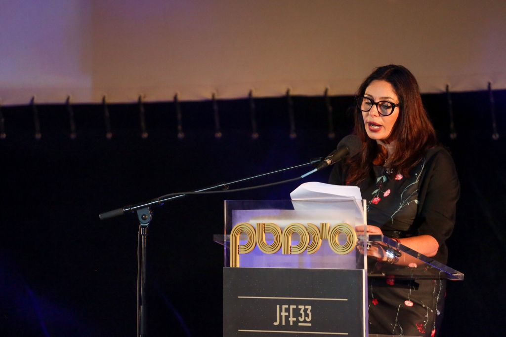 Culture minister Miri Regev speaks to the Jerusalem Film Festival crowd on July 8, 2016, and receives boos in return (Miriam Alster/Flash 90)