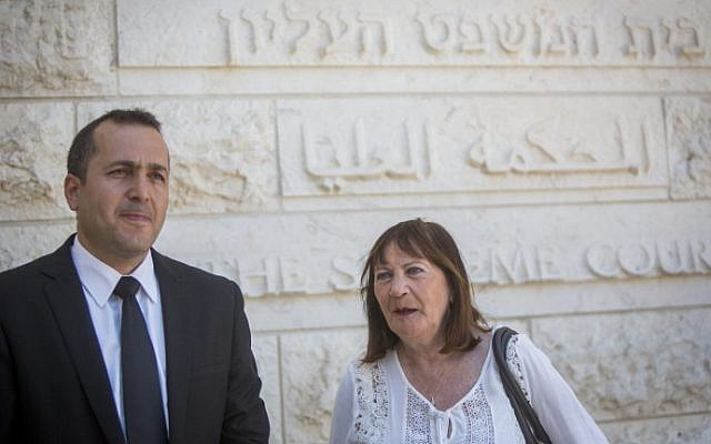 Zehava Shaul, mother of fallen Israeli soldier Oron Shaul, stands with her lawyer outside the Supreme Court in Jerusalem on July 10, 2016, after filing a petition to cancel benefits for Hamas prisoners in Israeli jails. (Yonatan Sindel/Flash90)