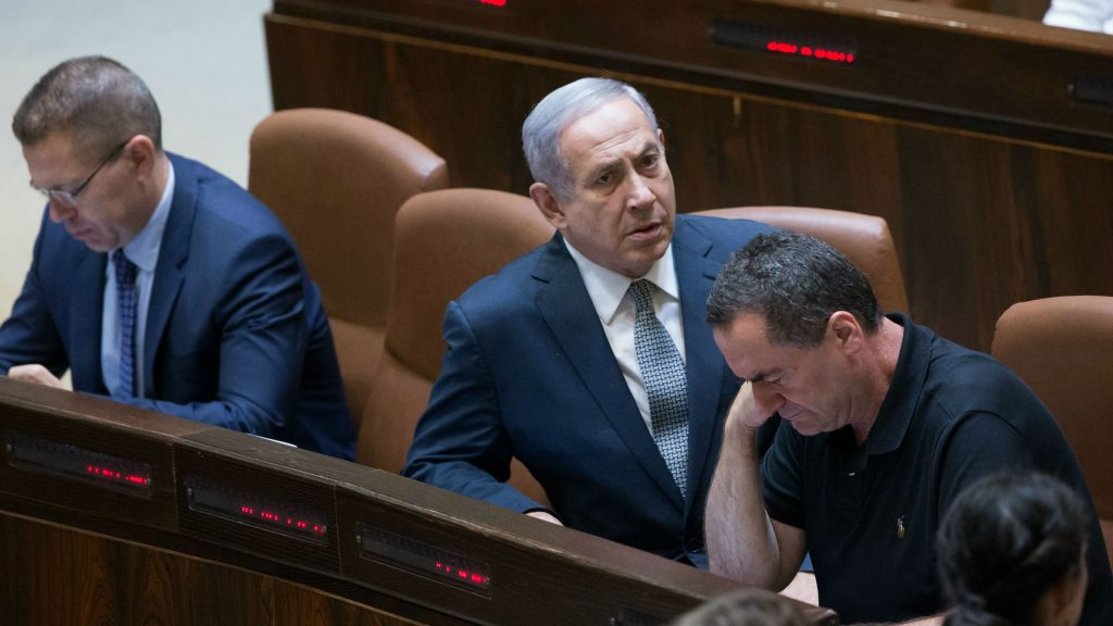Cabinet ministers in the Knesset plenum ahead of the vote on the controversial NGO bill, July 11, 2016. From left: Public Security Minister Gilad Erdan, Prime Minister Benjamin Netanyahu, Transportation Minister Yisrael Katz. (Yonatan Sindel/Flash90)