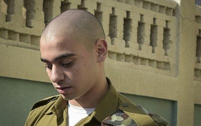 Elor Azaria, an Israeli soldier who killed a Palestinian stabber in Hebron, is seen outside a military court in Jaffa on July 24, 2016 (Flash90)