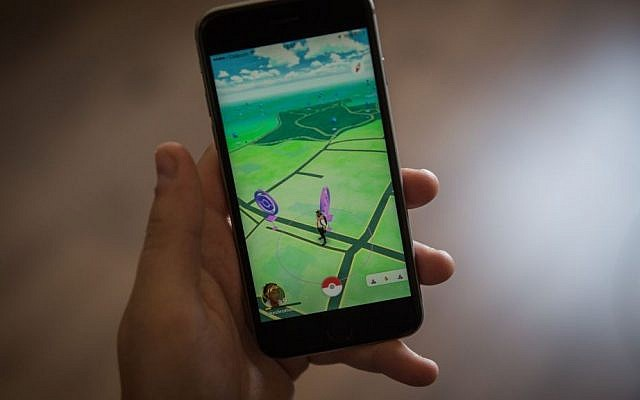 Illustrative photo of a young Israeli man playing Pokémon Go on his iPhone, on July 28, 2016. (Hadas Parush/Flash90)