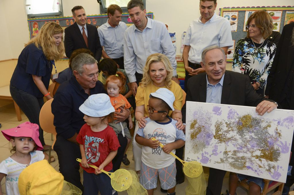 Prime Minister Benjamin Netanyahu and his wife Sara during a visit to Aleh Negev, a rehabilitation village for disabled children and adults near Ofakim in southern Israel, on July 28, 2016. (Haim Zach/GPO)