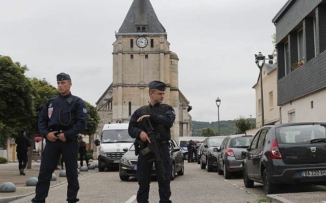 French riot police guards the street to access the church where an hostage taking left a priest dead in Saint-Etienne-du-Rouvray, Normandy, France, Tuesday, July 26, 2016. (AP Photo/Francois Mori)