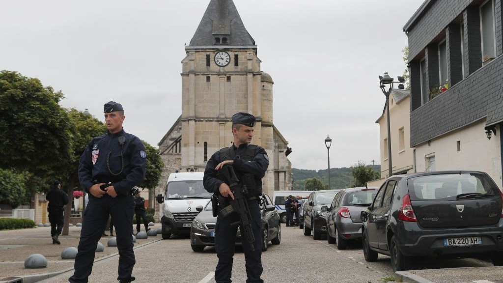 French riot police guards the street to access the church where a hostage-taking left a priest dead in Saint-Etienne-du-Rouvray, Normandy, France, Tuesday, July 26, 2016. (AP Photo/Francois Mori)