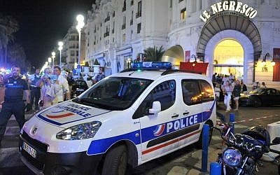 A police car is parked near the scene of a terror attack after a truck drove on to the sidewalk and plowed through a crowd of revelers who'd gathered to watch the fireworks in the French resort city of Nice, southern France, Friday, July 15, 2016. (AP Photo/Christian Alminana)