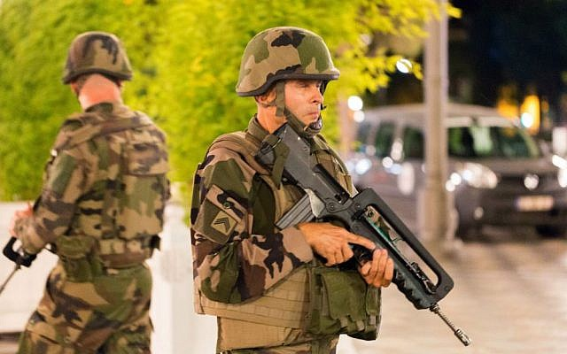 French soldiers stand guard by the sealed off area of a terror attack after a truck drove onto the sidewalk and plowed through a crowd of revelers who'd gathered to watch the fireworks in the French resort city of Nice, southern France, Friday, July 15, 2016. (AP Photo/Ciaran Fahey)