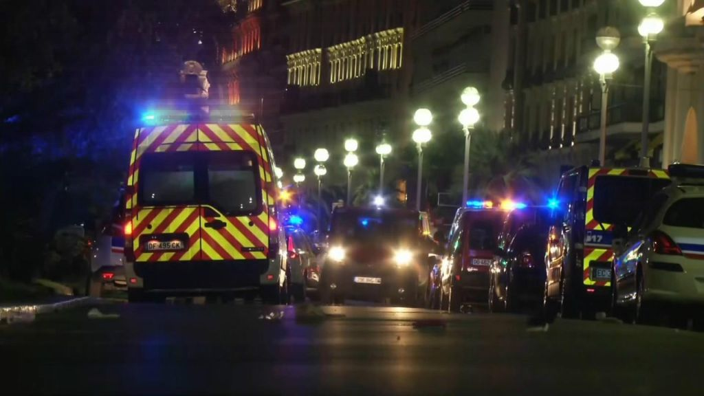 In this video grab taken Thursday July 14, 2016, ambulances and police cars are seen after a truck drove on to the sidewalk and plowed through a crowd of revelers who'd gathered to watch the fireworks in the French resort city of Nice. (BFMTV via AP)