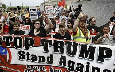 Protesters yell during a rally against Republican presidential candidate Donald Trump on Monday, July 18, 2016, in Cleveland, Ohio. (AP Photo/Patrick Semansky)