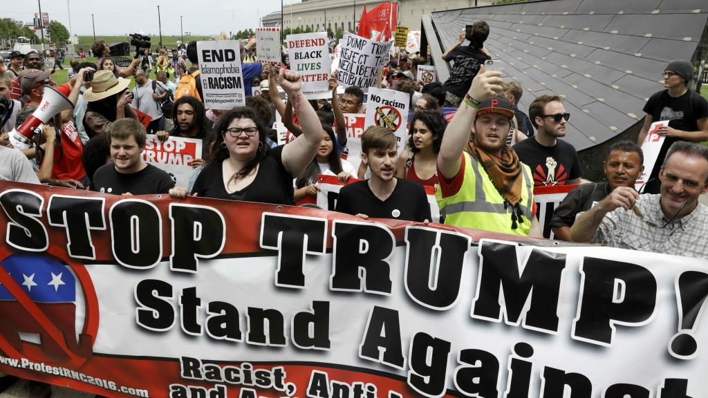 Cleveland peaceful as mass protests fail to materialize the times protesters yell during a rally against republican presidential candidate donald trump on monday july 18 publicscrutiny Image collections
