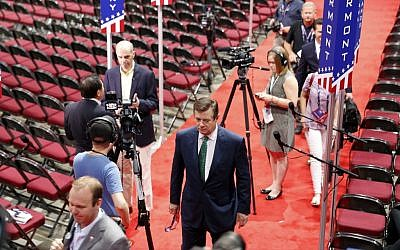 Trump Campaign Chairman Paul Manafort walks off the floor of the Republican National Convention, July 17, 2016, in Cleveland. (AP Photo/Carolyn Kaster)