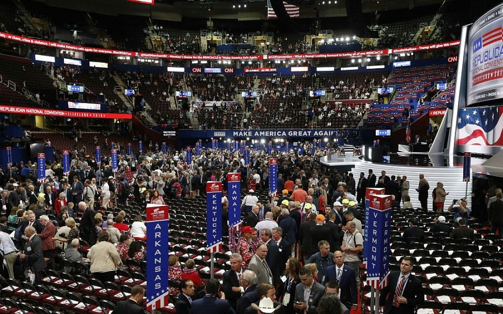 Delegates arrive at the Quicken Loans Arena before the start of the Republican National Convention in Cleveland, Ohio, Monday, July 18, 2016. (AP Photo/Paul Sancya)