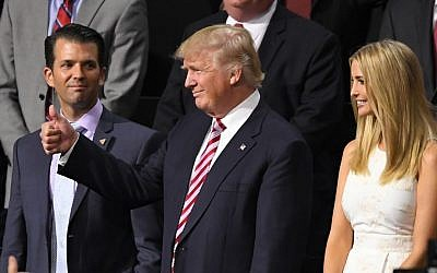 Republican Presidential Candidate Donald Trump, flashes a thumbs up as he arrives for son Eric Trump's speech during the third day of the Republican National Convention in Cleveland, Wednesday, July 20, 2016. (AP Photo/Mark J. Terrill)