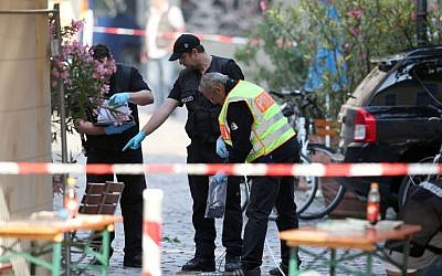 German police investigate at the site in Ansbach, Germany, Monday, July 25, 2016, where a failed asylum-seeker from Syria blew himself up. (Daniel Karmann/dpa via AP)